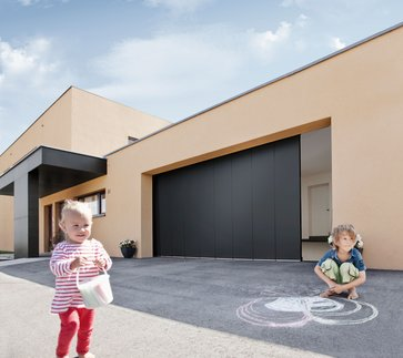 sektionaltor rolltor oder schwingtor garagentore f r ihr haus lagerhaus. Black Bedroom Furniture Sets. Home Design Ideas